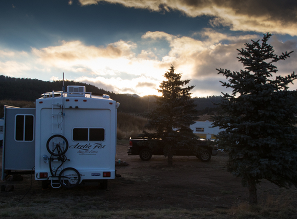 Sun setting on Arctic Fox fifth wheel while camping in Colorado