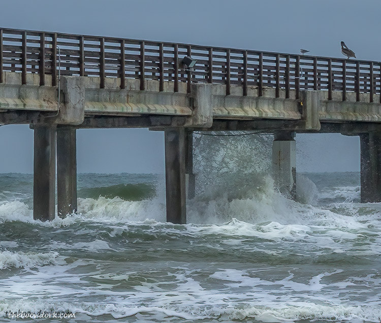 heavy surf at Bob Hall pier Padre island Texas